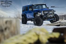 blue jeep wrangler adv 1 white and gold jeep wrangler or is it blue and black