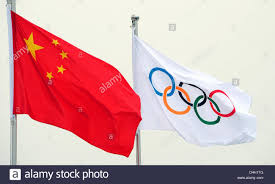 Chineses Flag The Chinese L And The Olympic Flag R Wave In Beijing China