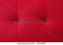 free red velvet couch background texture with sunken buttons