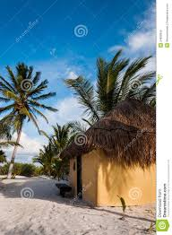cabanas huts on white sand beach in mexico tulum royalty free