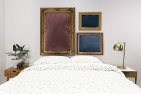 feng shui bed under window wall decor above curved headboard