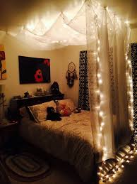 small rustic teenage bedroom design with white canopy bed