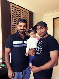 mohammad hafeez biography muhammed hafeez pictured with umar akmal his daughter