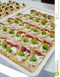cocktail party canape fruit desert cream tray concept stock photo