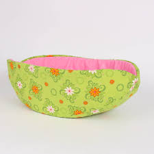 the cat canoe in bright green with pink lining the cat ball