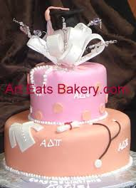 two tier orange and pink fondant clemson cake 2c lab coat 2c diploma 2c stethoscope 2c pearls 2c bow 2c crystal topper jpg