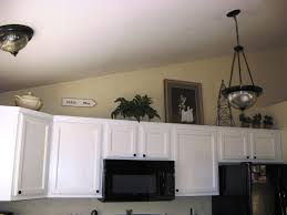 what do you put on top of kitchen cabinets kitchen upper cabinet design vaulted ceiling kitchen cabinets