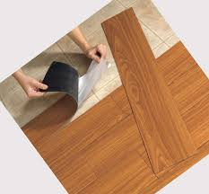 installing faux wood vinyl flooring that looks like wood planks