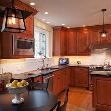 what backsplash looks with cherry cabinets cherry cabinets kitchen design ideas pictures remodel and