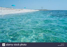 transparent blue water in is aruttas beach oristano sardinia