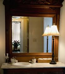 Mirror In The Bathroom The Beat Also Classic Wall Sconces Oval Mirror Bathroom