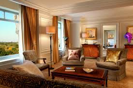 the royal suite the ritz carlton new york central park royal suite living room with plush seating around a wood coffee table crown molding and