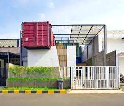 shipping container home across the front of two containers we
