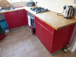 red kitchen cabinets red kitchen cabinets with black countertop15