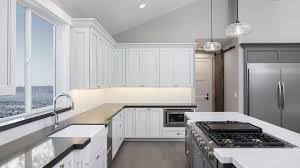 gray stained kitchen cupboards should you stain or paint your kitchen cabinets for a change