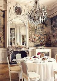 french interior in dining room with chandelier and wallpaper and
