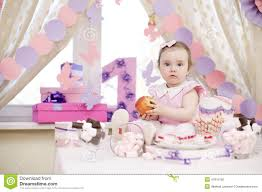 baby girl birthday table set up for a baby girl birthday party stock photo image