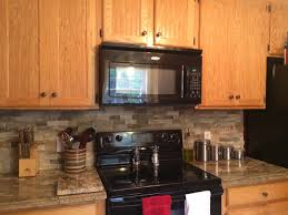 Kitchens With Stone Backsplash River Bordeaux Granite Countertops And Desert Sand Stone
