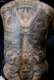 black and grey 3d asian dragon with yin yang tattoo on man full back