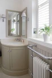 corner bathroom mirror perfect for powder room traditional powder room with hardwood