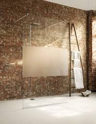 help and advice for frameless glass shower enclosures and screens a large fixed frameless glass shower screen including modesty panel in a luxurious wetroom
