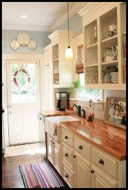 25 best cottage kitchens ideas on pinterest white cottage white cabinets butcher block countertops farmhouse sink and pretty blue walls i love this maybe not so much the blue walls but i love the cabinetry and