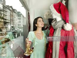 shop owner desiging the mannequin in her store stock photo getty