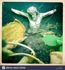 a sculpture of jesus christ crucified missing his hands decorates
