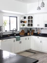black kitchen countertops with white cabinets white kitchen cabinets with black countertops are the next