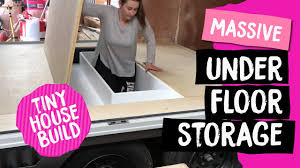 massive under floor storage for tiny house built in bed base