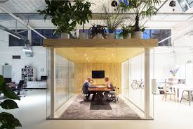 a garden is the roof of a meeting room in a loft office by