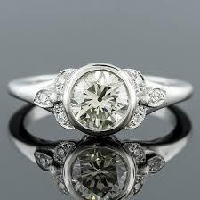 1414 1 art deco inspired pave set diamond bezel set center