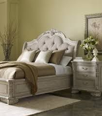 traditional king upholstered sleigh bed in light finish by a r t