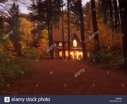 Twilight House Brick Country House Or Cottage With Lights On In Colorful Autumn