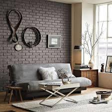 canap gris fonc murs papier peint brique marron canapé gris foncé tapis blanc