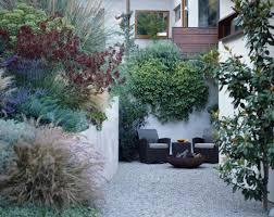 small city walled garden gravel courtyard mix of mediterranean