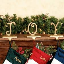 xmas stocking hangers fireplace mantle absurd decor hooks