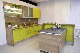 green and kitchen ideas like the way the wood wraps counter and sides island modern