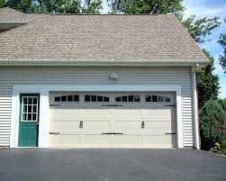 steel carriage garage doors 16 7 raised panel garage door a carriage house desert tan w arched