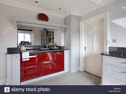 modern kitchen uk a red aga cooker in a modern kitchen in a home in the uk stock