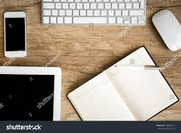 Wooden Table Top View Notebook Wit Tablet On Wooden Table Stock Photo 198592241