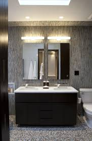 bathroom with black cabinets and mosaic backsplash tiles benevola