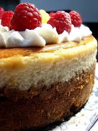 tender crumb cheesecake w red u0026 gold raspberries