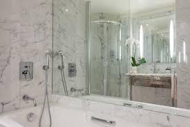 spacious marble bathroom in superior room at hotel balzac paris