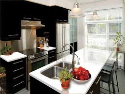 black wooden kitchen island and white wooden kitchen cabinet with