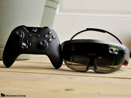 you can totally stream xbox one games to the hololens and play