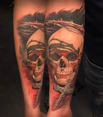 3d skull with cross on left forearm