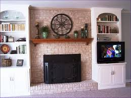 living room wonderful what to put above fireplace mantel ready