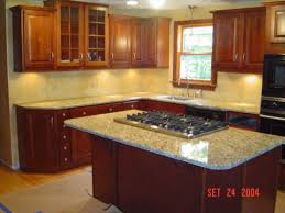 granite countertop antique cabinet pull tiling a kitchen wall