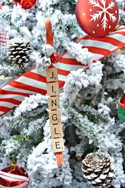 red and white candy cane themed flocked christmas tree mom 4 real